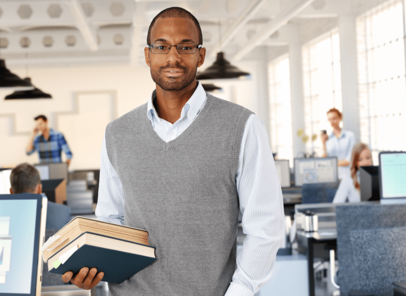 Masters of education in educational leadership student holding books