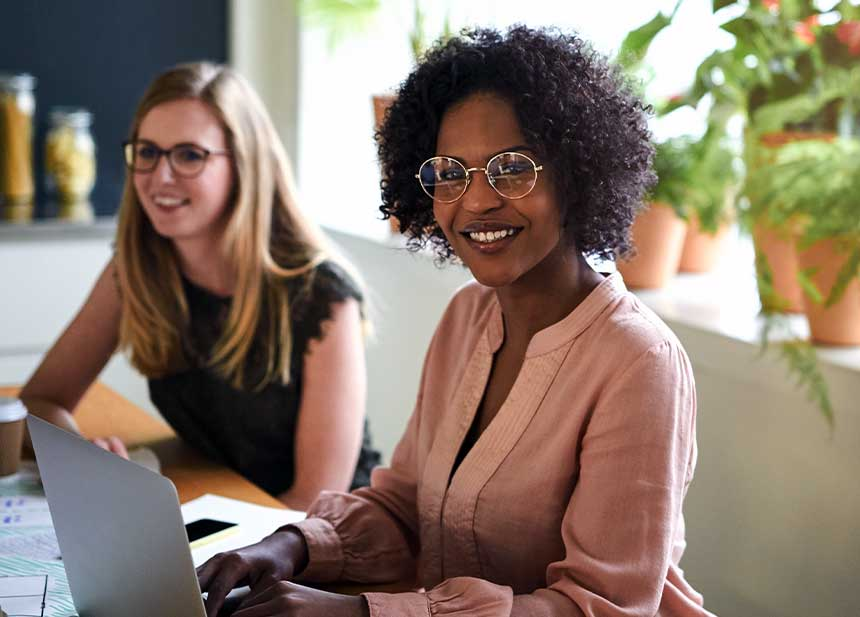 What Can You do With an MBA in Leadership? female students working